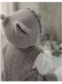 Hnědá dětská čepice s oušky